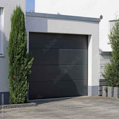 Fotografija Modern new garage door (sectional door)