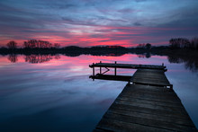Pink Sunset With Dramatic Clou...