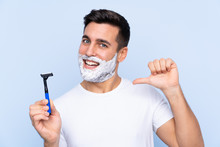 Young Handsome Man Shaving His...