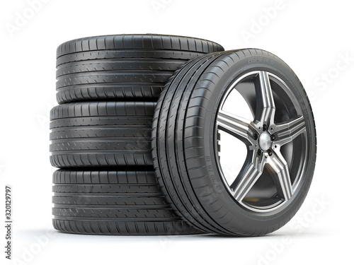 Cuadros en Lienzo Car wheel on alloy disc with tyre isolated on white.