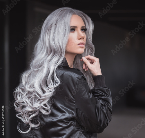 Portrait of beautiful girl with healthy long grey hair outdoor