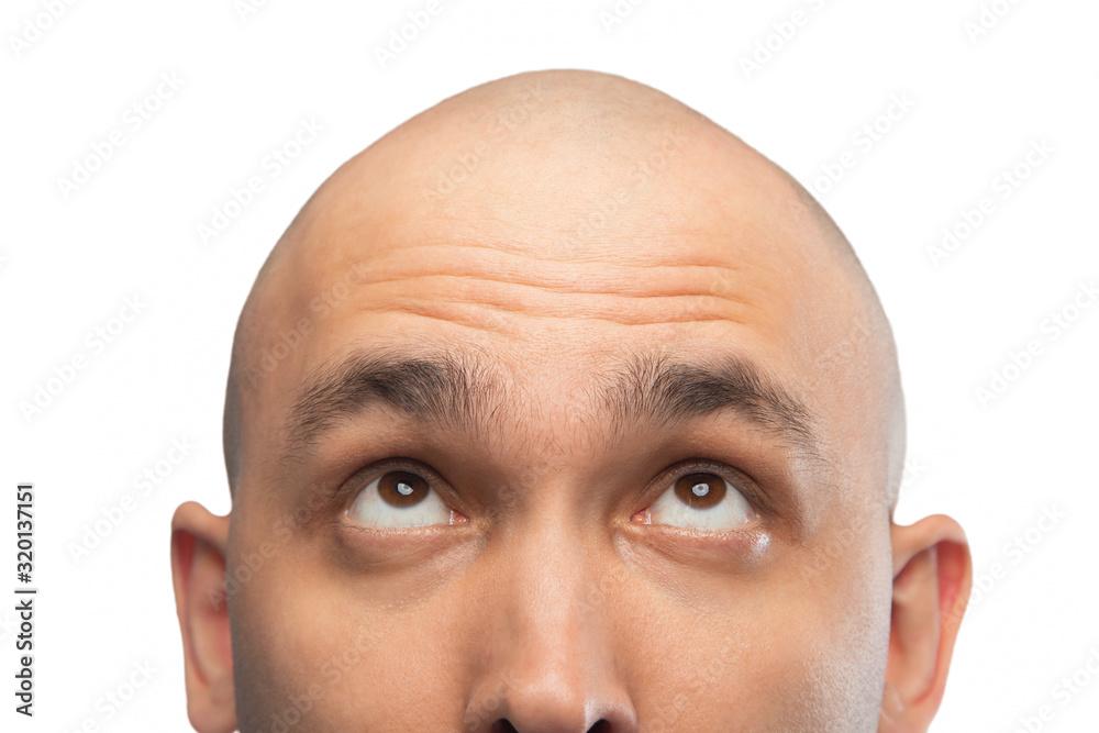 Fototapeta Image of bald man looking up, half head