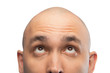 Image of bald man looking up, half head
