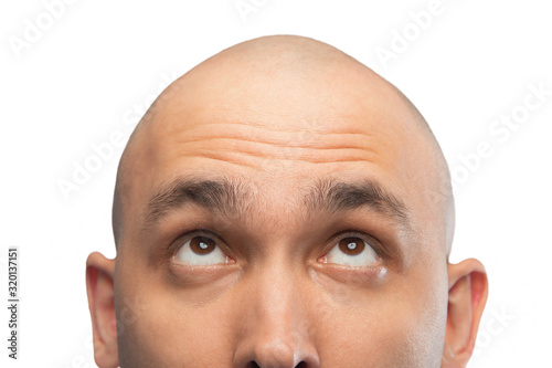 Fototapeta Image of bald man looking up, half head obraz