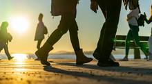 Backlit People Walking