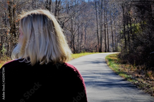 Rear View Of Woman Walking On Road Canvas Print
