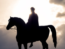 Silhouette Man Riding Horse Against Sky During Sunset