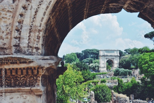 Arch Of Titus Amidst Trees Against Cloudy Sky Wallpaper Mural