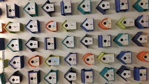 Fotografering Full Frame Shot Of Birdhouses On Wall