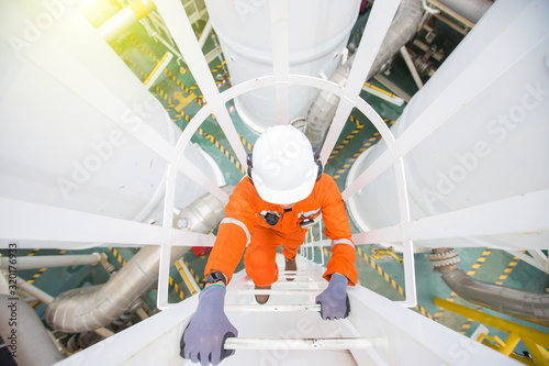 Fotografía Production operator climb up to oil and gas process plant to observer gas dehydration processing at offshore oil and gas central processing platform
