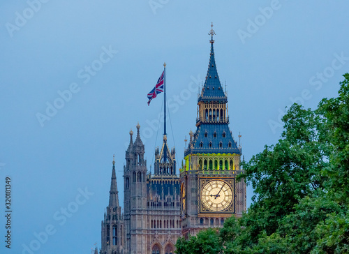 Big Ben By Palace Of Westminster Against Clear Sky Wallpaper Mural