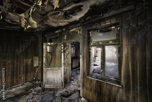 Inside shot of an abandoned destroyed building with burned walls and worn-out do Canvas Print