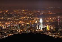 Mid Distance View Of Illuminated Petronas Tower And Kuala Lumpur Tower At Night
