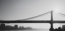 Panoramic View Of Manhattan Bridge Over East River Against Sky
