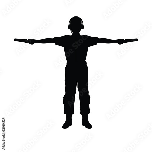 Aviation Marshaller silhouette vector / Supervisor meets passenger airplane at the airport Canvas Print