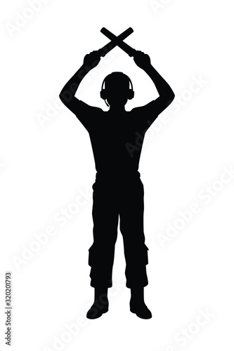 Photo Aviation Marshaller silhouette vector / Supervisor meets passenger airplane at the airport