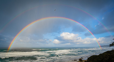 Beautiful double rainbow over the ocean off the oregon coast