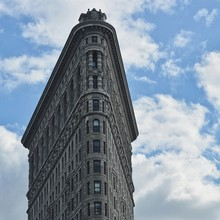 Low Angle View Of Flatiron Building Against Sky In City