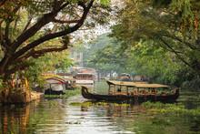 Beautiful Kerala Backwaters Landscape With Traditional Houseboats At Sunset