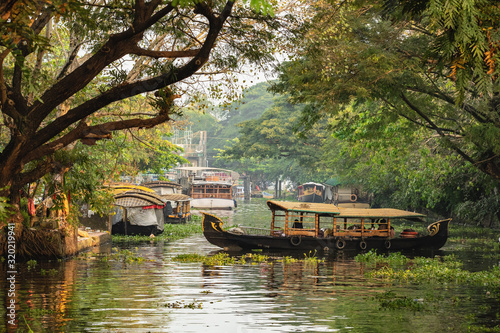 Beautiful Kerala backwaters landscape with traditional houseboats at sunset Canvas Print