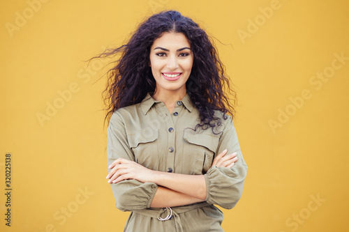 Young Arab Woman with curly hair outdoors Canvas Print