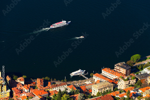 Fotografie, Obraz High Angle View Of Boats In Lake Como By Town