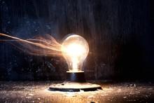 Blurred Motion Of Illuminated Light Bulb Exploding At Night
