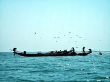 Silhouette Men On Boat In Sea Against Clear Sky
