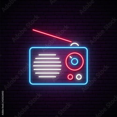 Fototapeta Neon radio sign. Vector radio receiver illustration in bright neon style. Concept design for World Radio Day. obraz