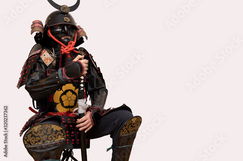 Canvastavla warrior with a black samurai armor posing with a white background