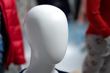 Head Of A White Mannequin Without Face On A Blue Background.