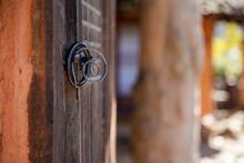 Metallic Door Knocker Tied With Spiral Wire