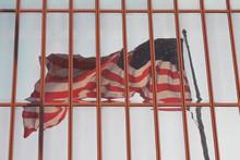 American Flag Reflecting On Glass
