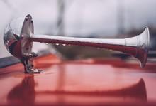Close Up Of Wet Red Vintage Car Horn