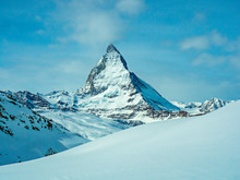 The Famous Beautiful Matterhorn Mountain 4478 M. View From The Gornergrat Mountain Zermatt, Switzerland. Great Design For Any Purpose. Snowy Winter Beautiful Landscape. Light Background.