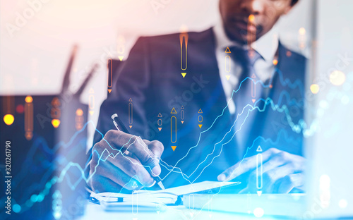 Fotomural African businessman in office, financial graph