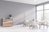 Fototapeta Kawa jest smaczna - Light gray dining room corner with cabinet