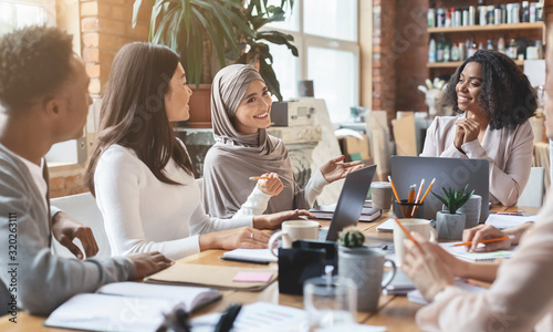 Obraz Young multiracial people having business meeting in office - fototapety do salonu