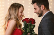 Gallant Man Presenting Roses Bouquet To His Happy Girlfriend