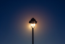 Low Angle View Of Lamp Post Against Clear Sky At Dusk
