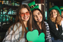 Young Women Celebrating St. Patrick's Day In Pub