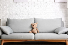 Cute Baby Toy On Sofa In Room