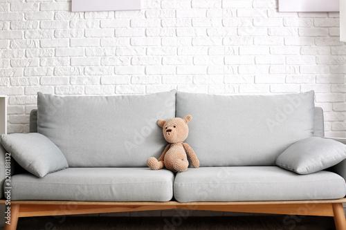 Fototapeta Cute baby toy on sofa in room obraz