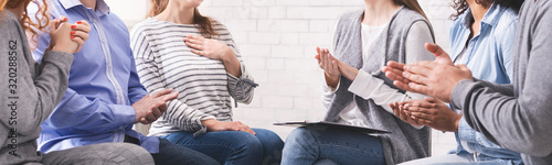 Group of unrecognizable people applauding to woman at psychotherapy session