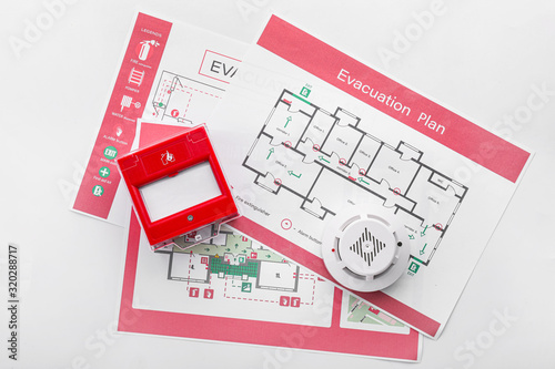 Valokuva Evacuation plans, smoke detector and manual call point on white background