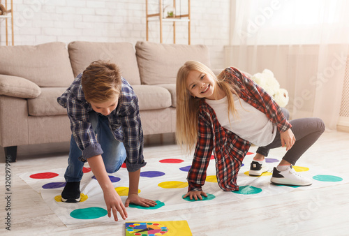 Boy And Girl Playing Twister Game Together On Floor Indoor Canvas-taulu
