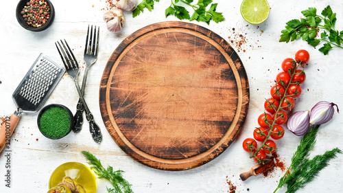 Obraz Food banner. Spices, vegetables and herbs on a white wooden background. Top view. free space for your text. Rustic style. - fototapety do salonu