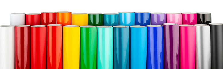 Row of various rainbow colored vinyl car wrapping or plotter cutting sticker plastic foil film rolls isolated white wide panorama banner background
