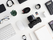 top view of photographer work station, work space concept with digital camera, memory card, keyboard and smartphone on white table background