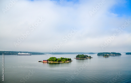 Photo Dwellings islands on Stockholm archipelago in Baltic sea at sunny morning, Swede